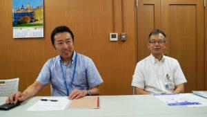 金沢市文化スポーツ局文化施設課の田村稔さん(写真左)と同課課長補佐の小鍛冶雅人さん